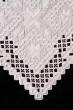 Detail of Hardanger cutwork table runner