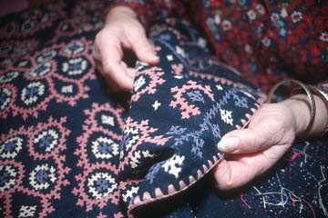 Anahid Kazazian holding a piece of Marash embroidery. Photo by Maggie Holtzberg.
