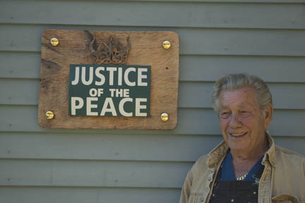 Joseph Johns outside his home. Photo by Maggie Holtzberg.