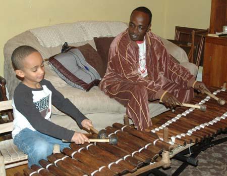 Sekou and Balla Kouyate playing balafons