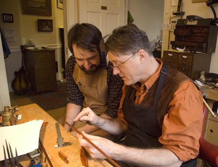 David Hawthorne teaching bowmaking to Joel Pautz