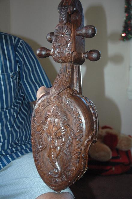 Carving of Ganesha on back of sarangi