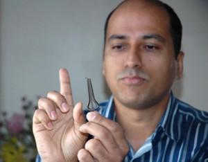 Sushil holding a jaw harp