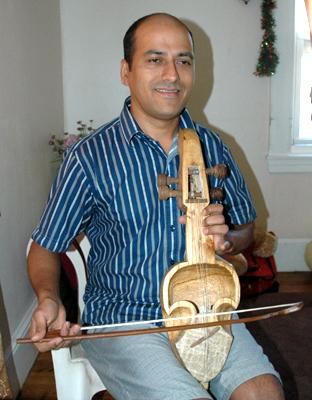 Sushil Gautam playing a Nepalese sarangee