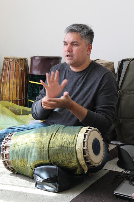 Gaurish Chandrashekhar teaching mridangum. Photo by Jennifer Atwood.