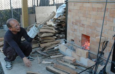 Yary Livan loading wood into firebox
