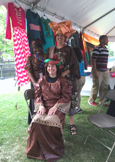 Rosaline Accam Awadjie (on right) with two festival goers that she has dressed in African headwraps and dress