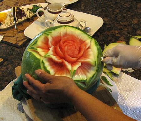 Ruben Arroco carving fruit