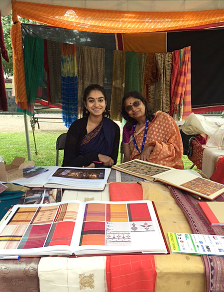 Jaya and Lakshmi in their booth at the folk craft area