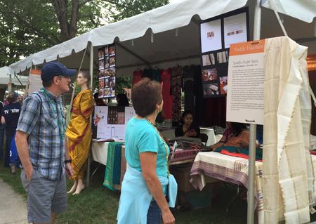 Festival goers looking at Lakshmi and Jaya's display
