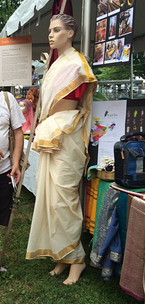 Mannequindressed in a white cotton Kerala sari