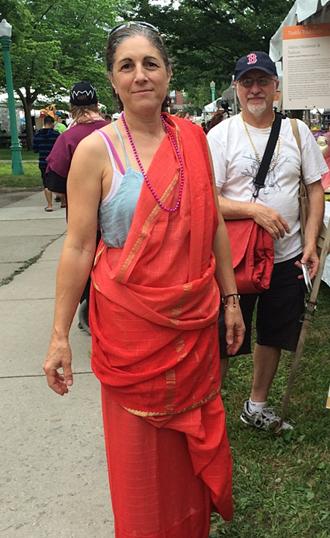 festival goer dress in red sari