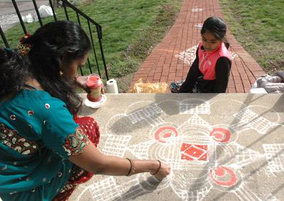 Watching Priya make kolam