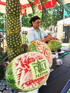 Ruben Arroco carving watermelon
